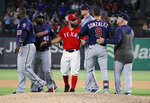 Minnesota Twins' Miguel Sano (22), Tommy Watkins (40), Marwin Gonzalez (9) and Texas Rangers' Rougned Odor, center, disperse after both benches cleared during the eighth inning of a baseball game in Arlington, Texas, Saturday, Aug. 17, 2019. (AP Photo/Tony Gutierrez)