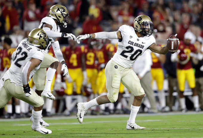 Colorado linebacker Drew Lewis (20) celebrates after intercepting a Southern California pass during the first half of an NCAA college football game Saturday, Oct. 13, 2018, in Los Angeles. (AP Photo/Marcio Jose Sanchez)