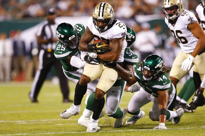 New Orleans Saints' Dwayne Washington (27) is tackled by New York Jets' Alex Brown (25) during the second half of a preseason NFL football game Saturday, Aug. 24, 2019, in East Rutherford, N.J. (AP Photo/Noah K. Murray)