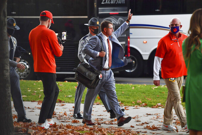 Clemson coach Dabo Swinney waves to fans as he enters the stadium for the team's NCAA college football game against Notre Dame on Saturday, Nov. 7, 2020, in South Bend, Ind. (Matt Cashore/Pool Photo via AP)