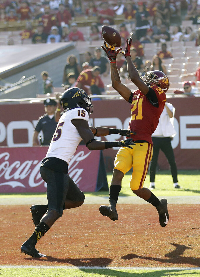 Southern California wide receiver Tyler Vaughns (21) catches a touchdown pass in front of Arizona State safety Cam Phillips (15) during the second half of an NCAA college football game Saturday, Oct. 27, 2018, in Los Angeles. (AP Photo/Marcio Jose Sanchez)