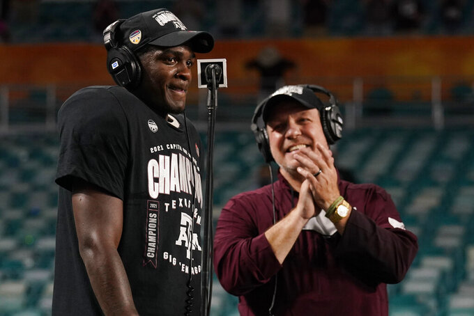 Texas A&M head coach Jimbo Fisher applauds as running back Devon Achane (6) is announced as the game MVP at the Orange Bowl NCAA college football game, Saturday, Jan. 2, 2021, in Miami Gardens, Fla. Texas A&M defeated North Carolina 41-27. (AP Photo/Lynne Sladky)