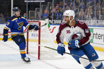 Colorado Avalanche's Pierre-Edouard Bellemare (41) looks back at he teammates after scoring an empty-net goal as St. Louis Blues' Torey Krug (47) skates in the background during the third period of an NHL hockey game Thursday, April 22, 2021, in St. Louis. (AP Photo/Jeff Roberson)