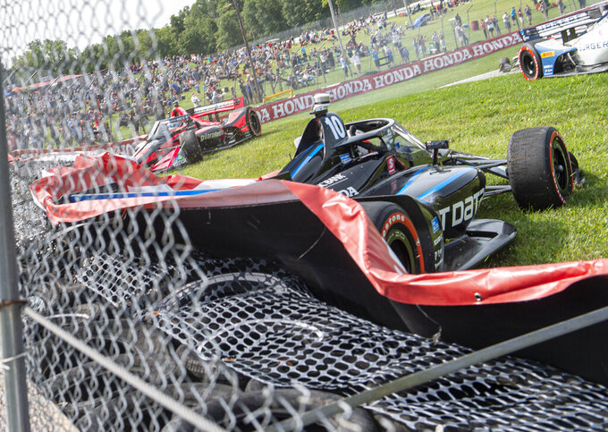 Felix Rosenqvist (10), of Sweden, hits the wall near the beginning of an IndyCar Series auto race at Mid-Ohio Sports Car Course, Sunday, Sept. 13, 2020, in Lexington, Ohio. (AP Photo/Phil Long)
