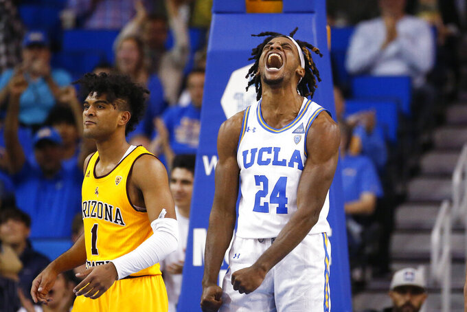 UCLA forward Jalen Hill (24) reacts after dunking against Arizona State guard Remy Martin (1) during the second half of an NCAA college basketball game Thursday, Feb. 27, 2020, in Los Angeles. (AP Photo/Ringo H.W. Chiu)