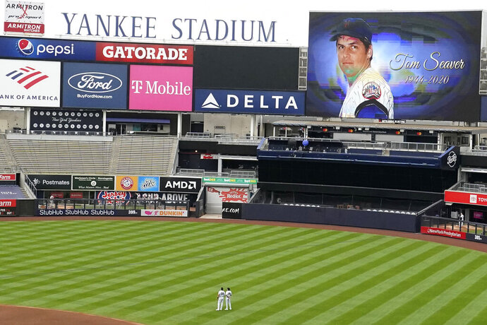 The Yankees honor New York Mets Hall of Fame pitcher Tom Seaver with a video tribute on the scoreboard before the start of a baseball game against the Baltimore Orioles, Sunday, Sept. 13, 2020, at Yankee Stadium in New York. Seaver died Aug. 31. (AP Photo/Kathy Willens)