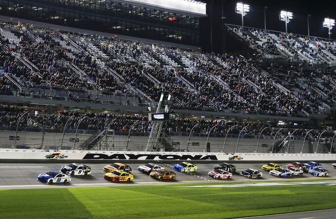 Alex Bowman (88) leads Chase Elliott (9), Joey Logano (22) and the rest of the field to start the second of two qualifying auto races for the NASCAR Daytona 500 at Daytona International Speedway, Thursday, Feb. 14, 2019, in Daytona Beach, Fla. (AP Photo/Terry Renna)