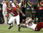 FILE - In this Sept. 1, 2018, file photo, Alabama running back Josh Jacobs (8) slips past Louisville defensive lineman Michael Boykin (41) for a gain during the first half of an NCAA college football game, in Orlando, Fla. Add Jaylen Waddle and Josh Jacobs to the list of No. 1 Alabama's dynamic playmakers. Both made big plays on offense and special teams in the opener. (AP Photo/John Raoux, File)