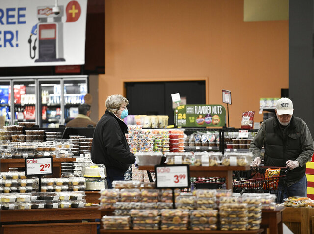 Seniors shop early for their groceries at the Johnstown, Pa. Giant Eagle on Tuesday, March 24 2020.  The Pittsburgh base company allows senior citizens to shop early between 6am and 7am before the general public during the COVID-19 pandemic.   (Todd Berkey/The Tribune-Democrat via AP)