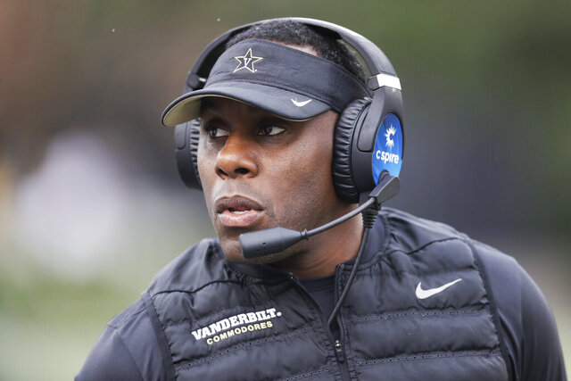 FILE — In this Oct. 19, 2019, file photo, Vanderbilt head coach Derek Mason watches from the sideline in an NCAA college football game against Missouri in Nashville, Tenn. Mason knows who his new starting quarterback is, but he isn't sharing his decision, not while looking for every advantage possible in the Commodores' season opener. (AP Photo/Mark Humphrey, File)