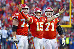 Kansas City Chiefs' Patrick Mahomes (15) celebrates a touchdown pass with Eric Fisher (72) and Mitchell Schwartz (71) during the second half of the NFL AFC Championship football game against the Tennessee Titans Sunday, Jan. 19, 2020, in Kansas City, MO. (AP Photo/Ed Zurga)