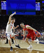 Texas Tech guard Matt Mooney (13) drives past Virginia guard Kyle Guy (5) during the first half in the championship game of the Final Four NCAA college basketball tournament, Monday, April 8, 2019, in Minneapolis. (AP Photo/David J. Phillip)