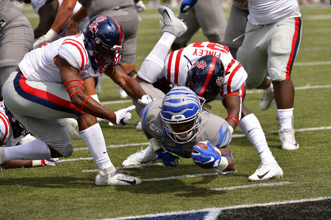 Memphis running back Kenneth Gainwell dives for the end zone as he is brought down by Mississippi defensive back A.J. Finley in the first half of an NCAA college football game Saturday, Aug. 31, 2019, in Memphis, Tenn. (AP Photo/Brandon Dill)