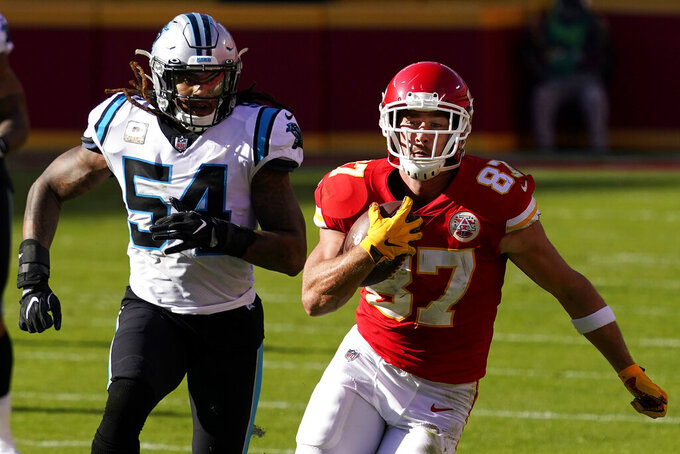 Kansas City Chiefs tight end Travis Kelce (87) runs in front of Carolina Panthers outside linebacker Shaq Thompson (54) during the second half of an NFL football game in Kansas City, Mo., Sunday, Nov. 8, 2020. (AP Photo/Jeff Roberson)