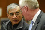 ADDS TO CLARIFY - IN ILLEGAL CAMPAIGN CONTRIBUTIONS TO COMMITTEES THAT SUPPORTED Real estate developer Samuel Leung, left, consults in court with his attorney Daniel V. Nixon as he faces charges of making nearly $200,000 in illegal campaign contributions to committees that supported Los Angeles Mayor Eric Garcetti and other Los Angeles politicians, in Los Angeles County Superior Court on Friday, Feb. 23, 2018, in Los Angeles. (AP Photo/Chris Pizzello)