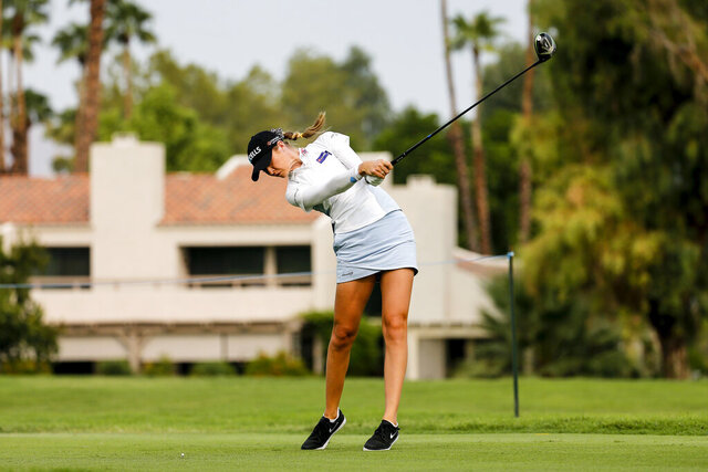 Nelly Korda hits her tee shot on the 12th hole during the second round of the the ANA Inspiration golf tournament at Mission Hills Country Club in Rancho Mirage, Calif., Friday Sept. 11, 2020. (AP Photo/Ringo H.W. Chiu)