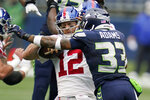 Seattle Seahawks strong safety Jamal Adams (33) sacks New York Giants quarterback Colt McCoy (12) during the first half of an NFL football game, Sunday, Dec. 6, 2020, in Seattle. (AP Photo/Elaine Thompson)