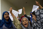 Kashmiri Muslim girls shout pro-freedom slogans during a demonstration after Friday prayers amid curfew like restrictions in Srinagar, India, Friday, Aug. 16, 2019. India's government assured the Supreme Court on Friday that the situation in disputed Kashmir is being reviewed daily and unprecedented security restrictions will be removed over the next few days, an attorney said after the court heard challenges to India's moves.(AP Photo/Dar Yasin)