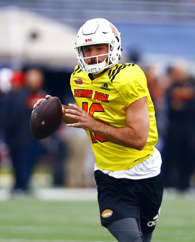 South quarterback Gardner Minshew II of Washington State (16) roll out to pass during practice for Saturday's Senior Bowl college football game, Tuesday, Jan. 22, 2019, in Mobile, Ala. (AP Photo/Butch Dill)