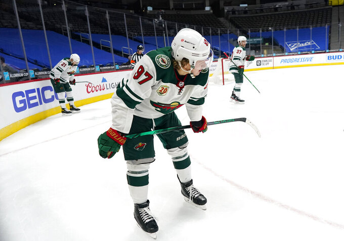 Minnesota Wild left wing Kirill Kaprizov, front, defenseman Carson Soucy, back left, and center Kyle Rau react at the end of the team's NHL hockey game against the Colorado Avalanche on Tuesday, Feb. 2, 2021, in Denver. (AP Photo/David Zalubowski)