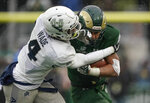 Colorado State running back Izzy Matthews (24) pushes off Utah State safety Aaron Wade (4) during the second half of an NCAA football game Saturday, Nov. 17, 2018, in Fort Collins, Colo. (AP Photo/Jack Dempsey)