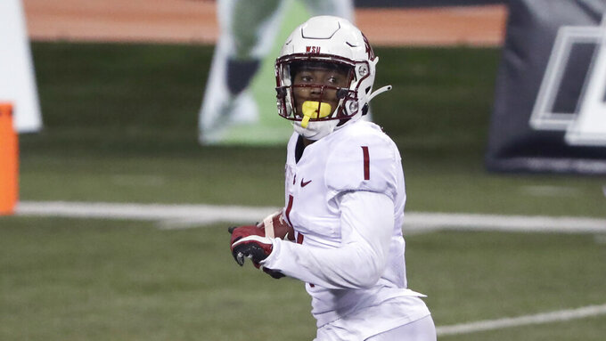 Washington State wide receiver Travell Harris runs 44 yards to score a touchdown during the second half of an NCAA college football game against Oregon State in Corvallis, Ore., Saturday, Nov. 7, 2020. Washington State won 38-28. (AP Photo/Amanda Loman)