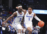 Memphis guard Tyler Harris (1) drives the ball past New Orleans Troy Green (3) in the first half of an NCAA college basketball game Saturday, Dec. 28, 2019, in Memphis, Tenn. (AP Photo/Karen Pulfer Focht)