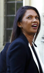 Anti-Brexit campaigner Gina Miller, centre leaves the Supreme Court in London, Wednesday, Sept. 18, 2019. The Supreme Court is set to decide whether Prime Minister Boris Johnson broke the law when he suspended Parliament on Sept. 9, sending lawmakers home until Oct. 14 — just over two weeks before the U.K. is due to leave the European Union. (AP Photo/Kirsty Wigglesworth)