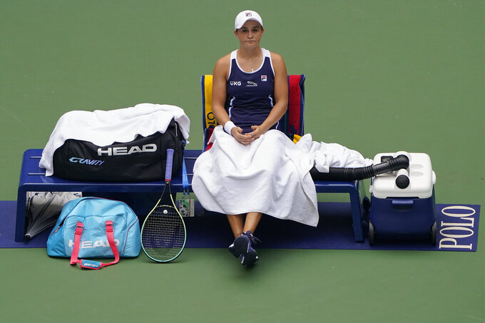 Ashleigh Barty, of Australia, waits during a break in play against Vera Zvonareva, of Russia, during the first round of the US Open tennis championships, Tuesday, Aug. 31, 2021, in New York. (AP Photo/John Minchillo)