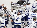 Tampa Bay Lightning's Nikita Kucherov (86) hoists the Stanley Cup after defeating the Dallas Stars in the NHL Stanley Cup hockey finals, in Edmonton, Alberta, on Monday, Sept. 28, 2020. (Jason Franson/The Canadian Press via AP)