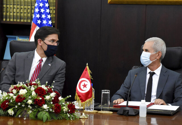 Tunisian Defense Minister Brahim Bartagi, right, talks with U.S Secretary of Defense Mark Esper in Tunis Wednesday, Sept. 30, 2020. US Defense Secretary Mark Esper arrived Wednesday in Tunisia, before heading to Algeria and Morocco. (AP Photo/Hassene Dridi)