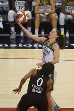 Seattle Storm's Sue Bird puts shoots against Indiana Fever's Kelsey Mitchell during the second half of a WNBA basketball game Thursday, June 17, 2021, in Indianapolis. (AP Photo/Darron Cummings)