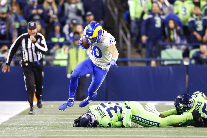 Los Angeles Rams wide receiver Cooper Kupp leaps over Seattle Seahawks safety Jamal Adams (33) during the second half of an NFL football game, Thursday, Oct. 7, 2021, in Seattle. The Rams won 26-17. (AP Photo/Craig Mitchelldyer)