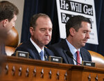 House Intelligence Committee Chairman Adam Schiff, D-Calif., left, responds to Rep. Devin Nunes, R-Calif, the ranking member, right, as the panel holds the first public impeachment hearings of President Trump's efforts to tie U.S. aid for Ukraine to investigations of his political opponents, on Capitol Hill in Washington, Wednesday, Nov. 13, 2019. (AP Photo/J. Scott Applewhite)