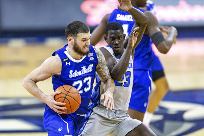 Seton Hall forward Sandro Mamukelashvili (23) drives to the basket as Creighton forward Damien Jefferson (23) defends during the second half during an NCAA college basketball game Wednesday, Jan. 6, 2021, in Omaha, Neb. (AP Photo/John Peterson)