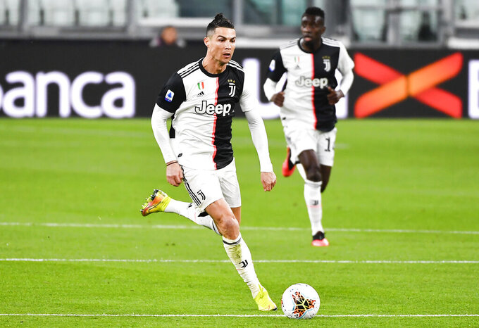 Juventus' Cristiano Ronaldo controls the ball during the Serie A soccer match between Inter Milan and Juventus at the Allianz Stadium in Turin, Italy, Sunday March 8, 2020. The match was played to a closed stadium as a measure against coronavirus contagion. (Marco Alpozzi/LaPresse via AP)