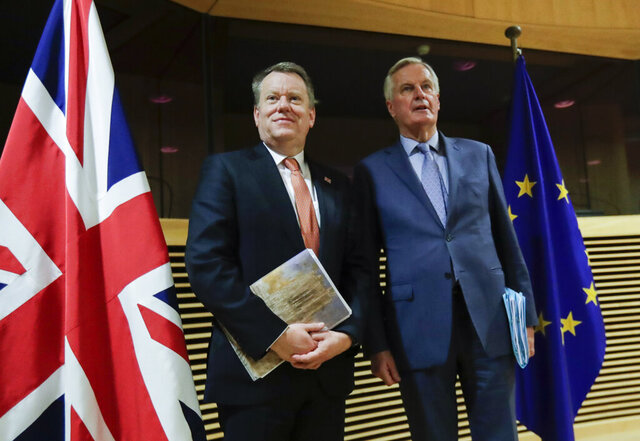 FILE - In this Monday, March 2, 2020 file photo, European Union chief Brexit negotiator Michel Barnier, right, speaks with the British Prime Minister's Europe adviser David Frost during Brexit trade talks between the EU and the UK, at EU headquarters in Brussels. EU and U.K. negotiators have yet to find a way to overcome