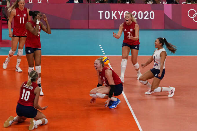 Players from the United States react after defeating Brazil to win the gold medal in women's volleyball at the 2020 Summer Olympics, Sunday, Aug. 8, 2021, in Tokyo, Japan. (AP Photo/Frank Augstein)