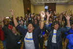 Supporters react as Louisiana Gov. John Bel Edwards arrives to address supporters at his election night watch party in Baton Rouge, La., Saturday, Nov. 16, 2019. On Saturday, voters reelected Edwards to a second term, as he defeated Republican businessman Eddie Rispone. (AP Photo/Matthew Hinton)