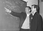 FILE - In this December 1965 file photo, Baltimore Colts quarterback John Unitas, left, and flanker back Jimmy Orr check a play diagram on the blackboard in Baltimore as the Colts prepared for an NFL football playoff game with the Green Bay Packers. Unitas was out for the season with a knee injury. Orr, a sure-handed wide receiver who played for the Pittsburgh Steelers and the Colts, died Tuesday, Oct. 27, 2020. He was 85. His death was confirmed Wednesday by Edo Smith and Sons Funeral Home in Brunswick, Ga. (AP Photo/William Smith, File)