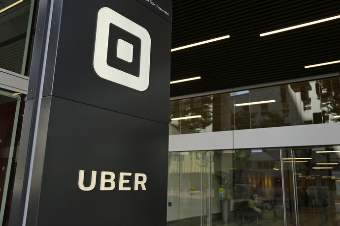 FILE - In this June 21, 2017, file photo, is a building that houses offices of Uber, in San Francisco. A former Uber executive was charged Thursday, Aug. 20, 2020, in federal court on allegations that he arranged $100,000 in a hush-money payment to hackers who stole the personal data of about 57 million of the ride-hailing service's users and drivers and then sought to cover up the massive 2016 breach, authorities said. (AP Photo/Eric Risberg, File)