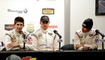 In this Friday, Jan. 5, 2018 photo, Penske team drivers, from left, Ricky Taylor, Graham Rahal and Helio Castroneves, of Brazil, answer questions at a news conference during testing for the IMSA 24 hour auto race at Daytona International Speedway in Daytona Beach, Fla. (AP Photo/John Raoux)