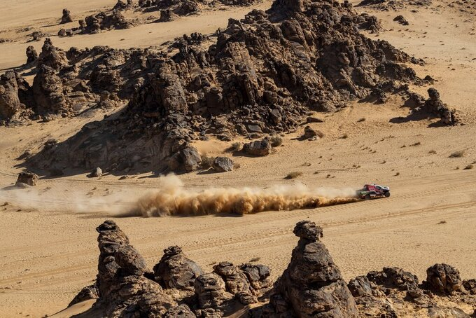 Driver Yazeed Al Qassimi, of Saudi Arabia, and co-driver Konstantin Zhiltsov, of Russia, race their Toyota during stage four of the Dakar Rally between Neom and Al Ula, in Saudi Arabia, Wednesday, Jan. 8, 2020. (AP Photo/Bernat Armangue)