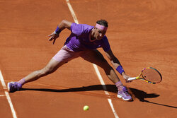 Rafael Nadal of Spain returns the ball to Alexei Popyrin of Australia during their match at the Madrid Open tennis tournament in Madrid, Spain, Thursday, May 6, 2021. (AP Photo/Paul White)