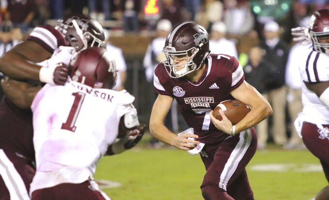 Mississippi State quarterback Nick Fitzgerald (7) breaks through a hole in the line of scrimmage and runs for a 76-yard touchdown during the second half of an NCAA college football game against Texas A&M, Saturday, Oct. 27, 2018, in Starkville, Miss. (AP Photo/Jim Lytle)