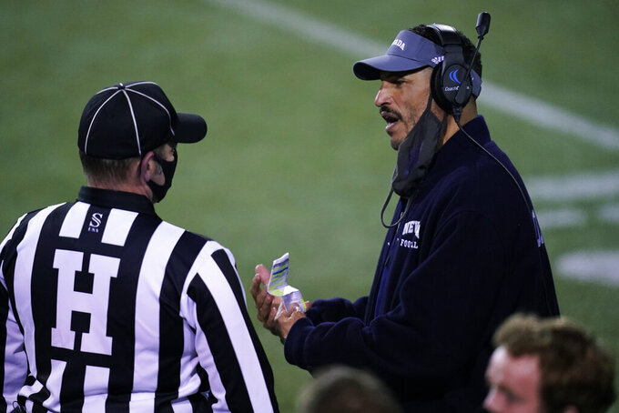 Nevada coach Jay Norvell speaks with an official during the second half of the team's NCAA college football game against San Jose State, Friday, Dec. 11, 2020, in Las Vegas. (AP Photo/John Locher)