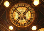 This Oct. 29, 2019 photo shows a close-up of one of Louis Comfort Tiffany's stained glass and bronze lights in the lobby of the Hudson Theatre on West 44th Street in New York. A newly launched tour of the Hudson Theatre offers a rare chance to wander around the interior of Broadway's oldest theater and hear some of the fascinating stories that have happened in its 116 years. (AP Photo/Mark Kennedy)