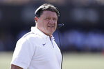 LSU head coach Ed Orgeron watches from the sideline in the first half of an NCAA college football game against Vanderbilt Saturday, Sept. 21, 2019, in Nashville, Tenn. (AP Photo/Mark Humphrey)