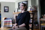 Mindy Nagel smiles as she is interviewed at her home, Monday, April 1, 2019, in Cincinnati. Mindy usually votes Democratic; while husband Tom usually goes Republican. But that's only part of it: their bedroom is in Ohio's 1st congressional district while their garage is in the 2nd. (AP Photo/John Minchillo)