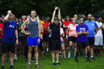 People at the start line of the Park Run at Bushy Park in London, Saturday July 24, 2021, one of many runs taking place across the country for the first time since March 2020 when the event was closed due to the COVID-19 pandemic. (Victoria Jones/PA via AP)